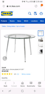 Ikea glass round dining table.
