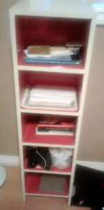 Stylish slim white bookcase (red inside); great condition!
