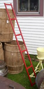 Antique red metal display or Ladder