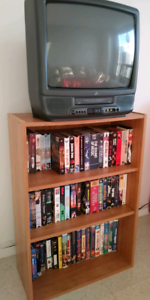 Color TV-VCR  -stand: 15 -videos: 15 -TV: 20