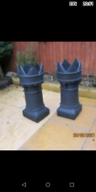 Pair of crown chimney pots now used as planters