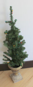 Tree with multi-colored lights in golden urn (Christmas decor)