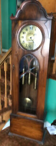Vintage grandfather clock and chair for sale.