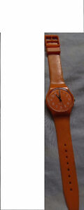 LADIES ORANGE  WATCH BY '' SWATCH'' FOR SALE
