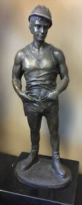 Solid bronze statue of a sexy construction guy