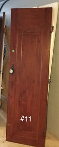 16 Antique Gumwood Doors. Circa 1937. Crystal knobs