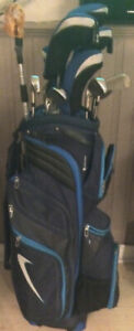 Golf clubs with bag and two wheel pull cart.