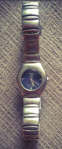 **LADIES ROOTS STAINLESS STEEL WATCH FOR SALE**