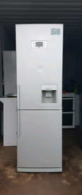Tall LG Stainless steel Fridge Freezer with water Dispenser.