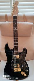 Black partscaster strat style guitar