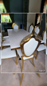 Dinning room table x 8 chairs white n gold