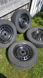 "4 x Winter Tires 15"" + Rims. 4 Lug Nut. from Chev. Cobalt"