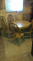 light oak table with 6 chairs 1 big leaf