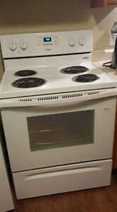 1 year old Whirlpool stove - and fridge