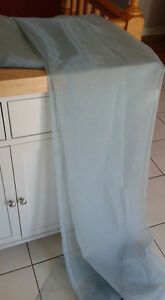 Pair of pale blue sheer curtains from Ikea.
