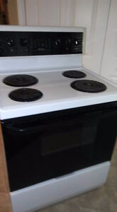 Frigidaire conviction stove and range hood.