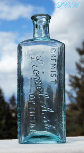 CHOICE antique OPTICIAN - EYE REMEDY hand blown EMBOSSED medicine bottle