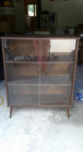 Cabinet with glass sliding doors