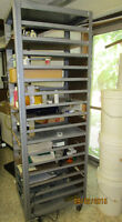 Steel shelving stand with 17 shelves supports