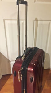 Hardside spinner carry-on suitcase
