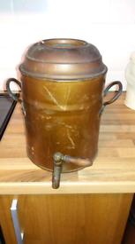 Antique copper coated water urn