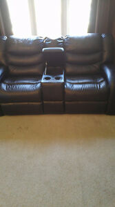 2 matching leather loveseats