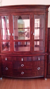 Dark cherry china cabinet with glass shelves and doors.