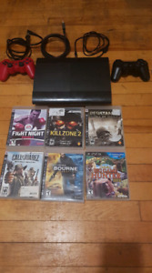 PS3 Slim w/ Games and 2 Controllers