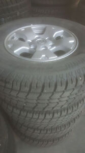 245/75R16 Like new winter tires on Toyota rims