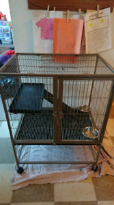 Large animal cage for small pets or animals.