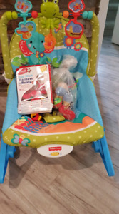 Baby rocking bed with other baby toys and baby harness.
