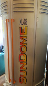 Sundome stand up  tanning  unit . 48 bulbs. Speakers