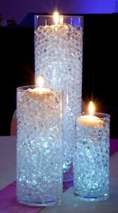 Gems and vases (wedding centrepieces or decorations)