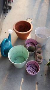 A whole bunch of plant pots and garden stuff