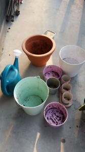 Assorted plant pots and garden supplies