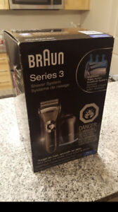 BRAND NEW SHAVER NEVER BEEN TAKEN OUT OF BOX