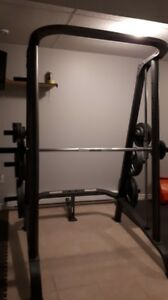 Smith Machine plus 500 lb weight plus pulldown, bench and leg ex
