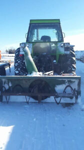 Farm tractor with snow blower