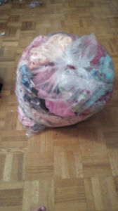 A bag of baby girl clothes size 0-9m