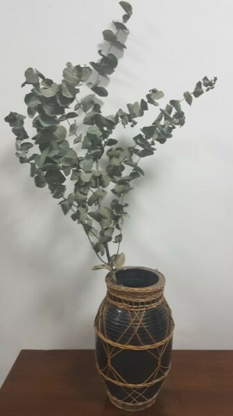 Rustic terracotta clay vase pot wrapped with cane