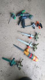 Assortment of broken/not needed irrigation/sprinkling equipment