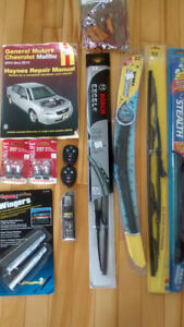 Floor mats, wipers, bulbs, repair manual