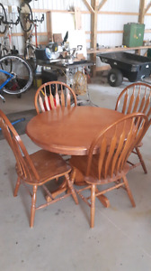 Oak pedestal table with extension and 4 chairs