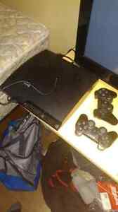 Ps3 with two controllers and tons of games