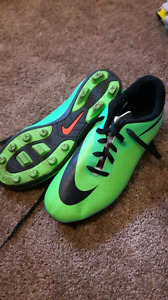 Green Nike women's cleats