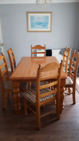 Solid pine dinning table an six chairs in good condition.