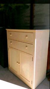 Light wood beige coloured solid wood dresser