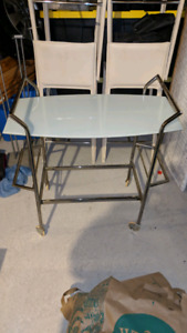 Rolling glass side table
