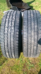 Two Good Year Wrangler LT 265 60 R20 all season tires.
