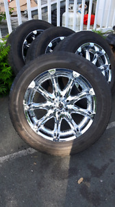 20 in Chrome rims and tires